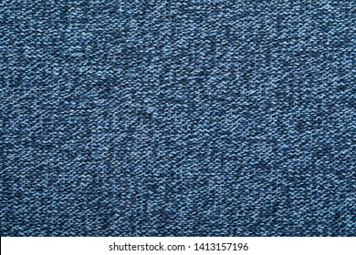 Dark blue melange knitted fabric made of heather mixed yarn textured background