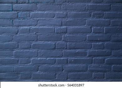 dark blue painted horizontal part of brick wall