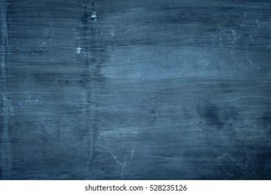 dark blue painted plaster surface