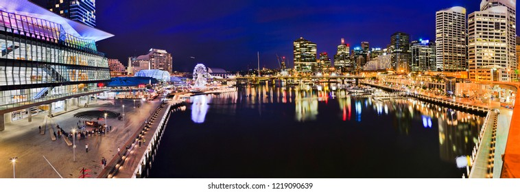 Dark blue panorama of Darling Harbour Cockle bay with surrounding high-rise buildings of urban architecture of modern city SYdney, Australia.