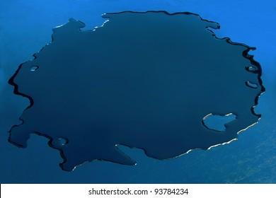 Dark blue puddle. Blue background.
