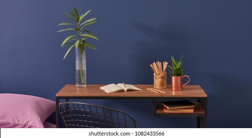 dark blue room wooden table and flowers home study room.