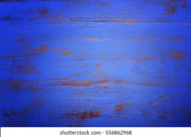 Dark blue rustic distressed on reclaimed wood background, with applied dark vignette filters.