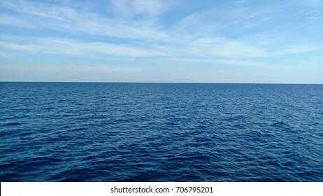 Dark blue sea and light blue sky