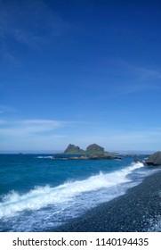 Dark blue sea and dark blue sky