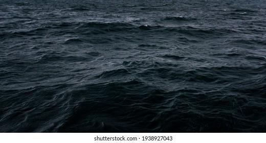 Dark blue sea water surface
