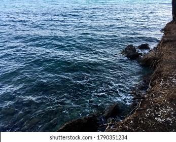 Dark blue sean and the brown coast