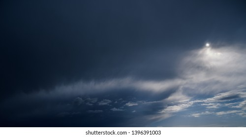 Dark blue sky with clouds. Nature background.