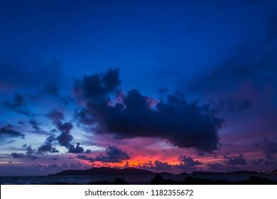 Dark blue sky on Twilight in the Evening over Sea and Silhouette island,Dramatic Sunset on Nightfall,Amazing Dusk sky with sunlight nightfall,Majestic Nature Background.