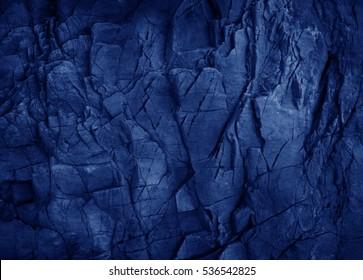 Dark blue slate background or texture.