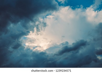 Dark blue stormy dramatic clouds in sky with copy space. For background and wallpaper