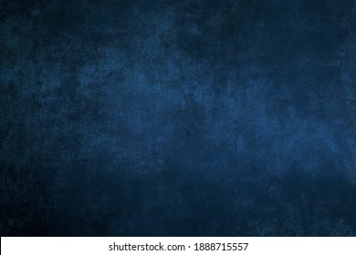 Dark blue stucco wall grungy background or texture