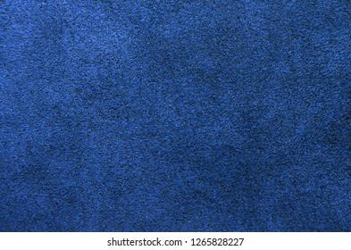 Dark blue suede background.