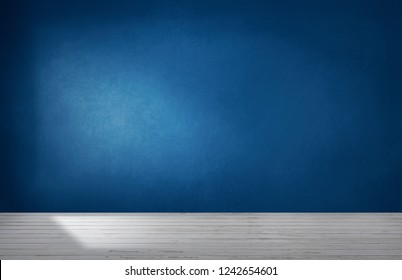 Dark blue wall in an empty room with a concrete floor