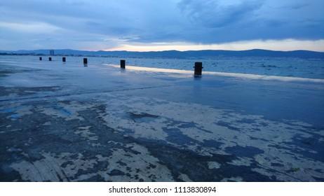 dark blue weather clouds sea landscape seascape pier