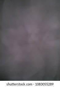 Dark blurred abstract background image of white and gray design color soft light backdrop with blank space.