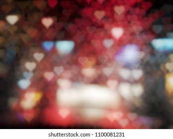 Dark blurred colorful heart shape bokeh from raindrops with lighting on night time for abstract background.