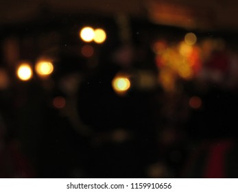 Dark blurry background with circle lights and copy space