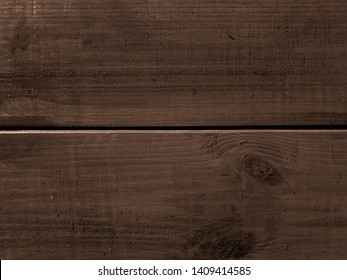 Dark boards of an old village house. Texture and Background