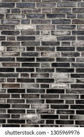 dark Brick wall for a background, front view