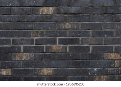 Dark brick wall with even surface, background for template, no person