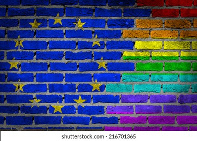 Dark brick wall texture - coutry flag and rainbow flag painted on wall - EU