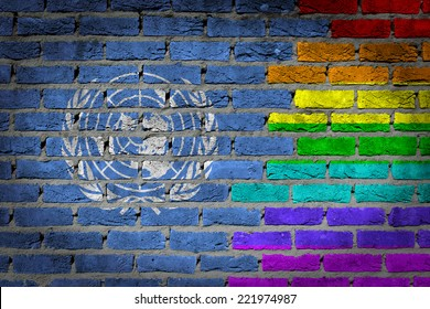 Dark brick wall texture - coutry flag and rainbow flag painted on wall - United Nations