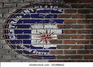 Dark brick wall texture - flag painted on wall - CIA
