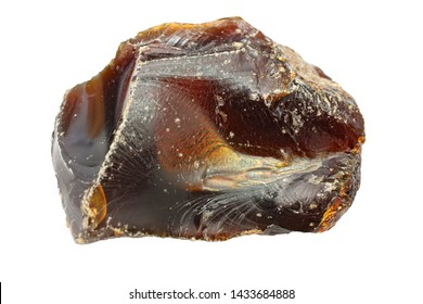 Dark brown amber on a white background. Fossil petrified resin. Ancient fossil resin of tropical trees. Natural mineral. Sun stone. Crystal. The origin of amber stone. Ancient fossil material