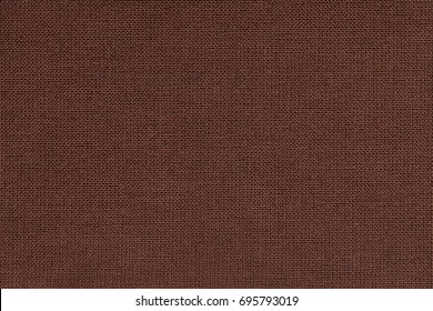 Dark brown background from a textile material with wicker pattern, closeup. Structure of the bronze fabric with natural texture. Cloth backdrop.