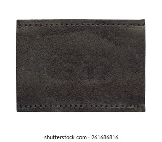 dark brown blank leather jeans label on white
