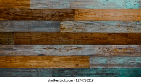 Dark brown blue and teal weathered wood boards. Reclaimed wooden planks with grain and texture.