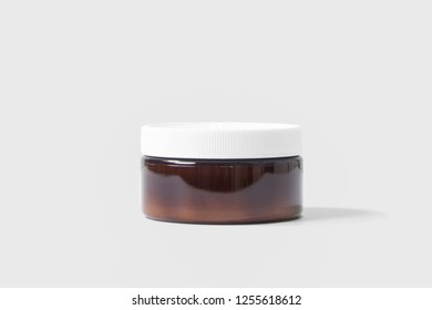 Dark Brown Glass Jar With Plastic Lid. Mock up brown glass jar for cream, gel, pill, chemical, pharmacy bottle.High resolution photo.