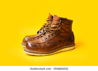 Dark Brown leather vintage boots on Yellow background, Vintage boots, Moc toe - Shutterstock ID 1946836561