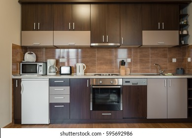 Dark brown modern kitchen interior