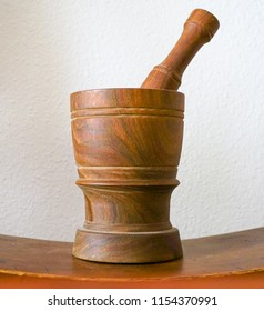 A dark brown Mortar and Pestle spice, herb and pill crusher set