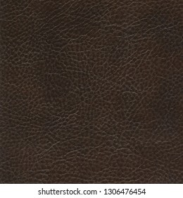 Dark brown natural leather textured background. Vintage fashion background for designers and composing collages. Luxury textured genuine leather of high quality.