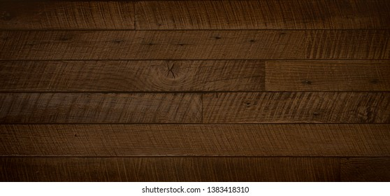Dark brown reclaimed wood surface with aged boards. Wooden planks with grain and texture. Neutral flat vintage wood background.