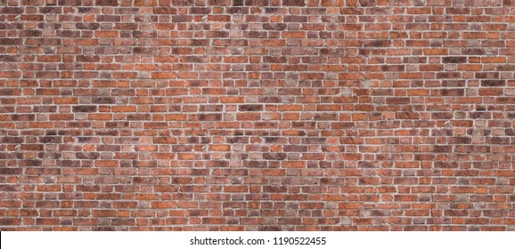 Dark Brown Or Red Old Brick Wall, Panorama. Brickwork Background Or Texture. Copy Space For Text Or Banner Or Graffiti.