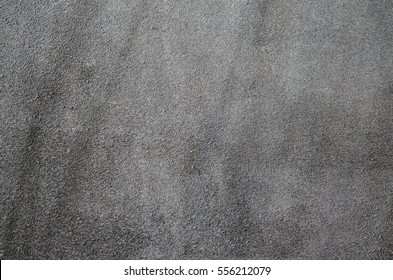 Dark brown suede soft leather as texture background. Close up shammy leather texture