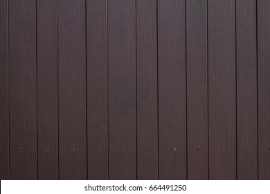 Dark brown wood texture background. wood plank with pattern for design and cement striped wood wall vertical plank. Wood substitute board and high quality fiber cement board texture