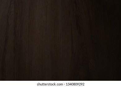 Dark brown wood texture natural background.