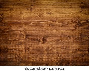 A dark brown wooden background