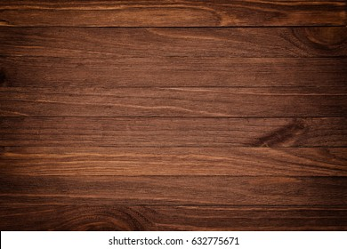 Dark brown wooden background with high resolution. Top view Copy space