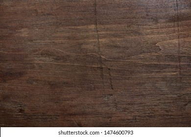 Dark brown wooden background. Scratched wooden wall. Shabby wood texture.
