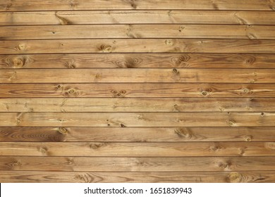 Dark brown wooden fence for abstract wooden backgrounds and textures. Wood horizontal panels with knots.