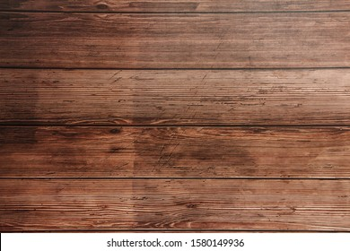 Dark brown wooden surface. Texture for background