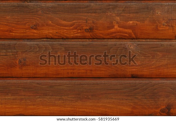 dark brown wooden wall made of boards