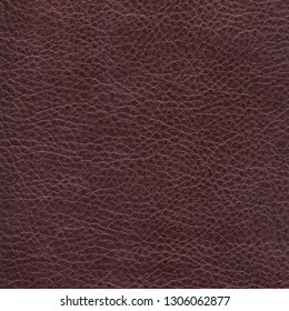 Dark browny - violet natural leather textured background. Vintage fashion background for designers and composing collages. Luxury textured genuine leather of high quality.