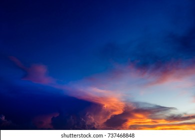 Dark bue Sky,Colorful and Amazing Dramatic Sunset in the evening on Twilight with Storm Cloud,Majestic fantastic nature,idyllic beautiful sunlight on cloud fluffy,well use as background.
